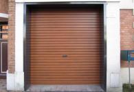 Porte de garage acier à enroulement chêne doré